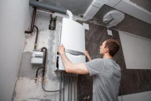 installation-setting-new-gas-boiler-hot-water-heating Compare Boiler Quotes