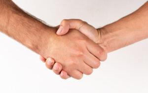 Side view men shaking hands agreement sign on white background. Compare Boiler Quotes