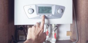 worker set up central gas heating boiler at home Compare Boiler Quotes